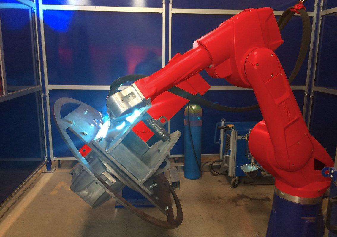 Fabrication using robotic welding arm